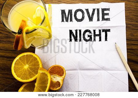 Conceptual Text Caption Showing Movie Night. Concept For Wathing Movies  Written On Tissue Paper On