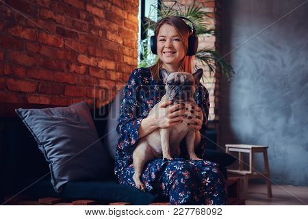 Studio Portrait Of An Attractive Happy Blonde In A Room With A Loft Interior.
