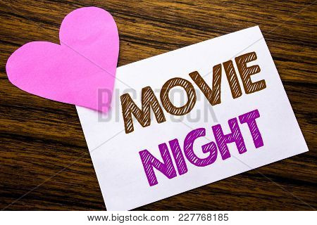 Conceptual Hand Writing Text Showing Movie Night. Concept For Wathing Movies  Written On Sticky Note