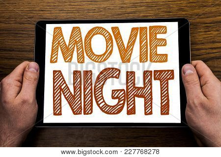 Hand Writing Text Caption Movie Night. Business Concept For Wathing Movies  Written Tablet Laptop, W