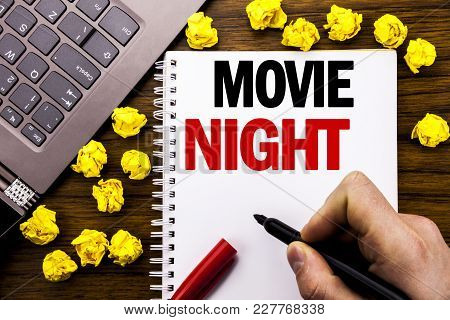 Conceptual Hand Writing Text Caption Movie Night. Business Concept For Wathing Movies  Written On Ta