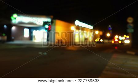 Night In The City, Supermarket And Road. Defocused Background. Night In The City.