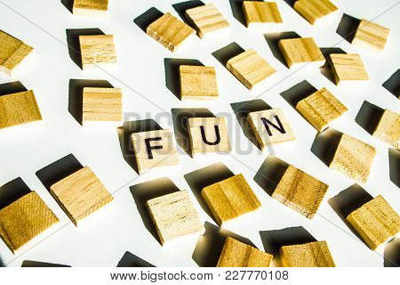Word Fun. Wooden Letters Spelling The Word Fun On White Background.