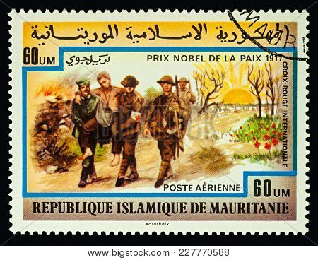 Moscow, Russia - February 21, 2018: A Stamp Printed In Mauritania Shows Group Of Soldiers With Wound