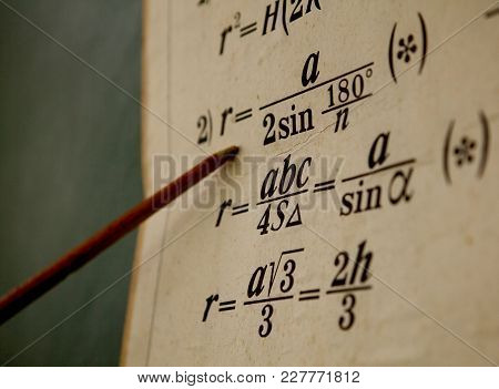 The Pointer Points To The Formula On The Old Paper.