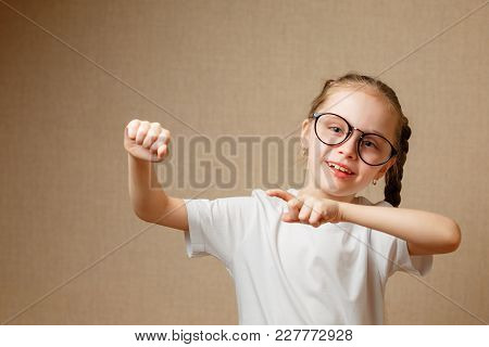 Educational Theme: Little Girl Raising Finger In Funny Attention Gesture