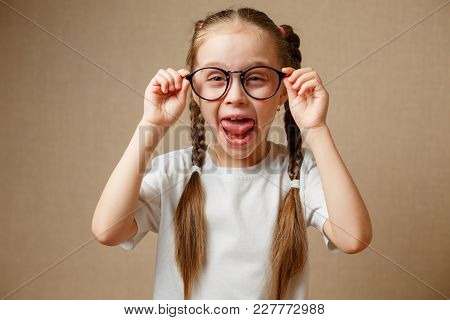 Portrait Of A Little Girl With Glasses