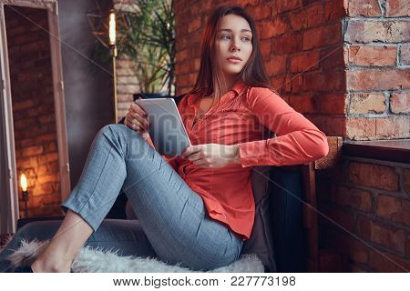A Charming Brunette In A Room With Loft Interior.