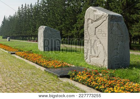 Omsk, Russia - June 21, 2016: Monoliths Of Granite On The Road Of War With Carved Years And Military