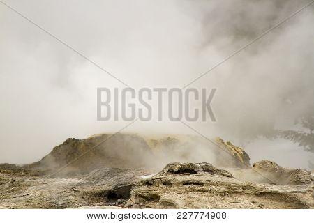 Steam From Erupting Geyser In Upper Geyser Basin, Yellowstone National Park