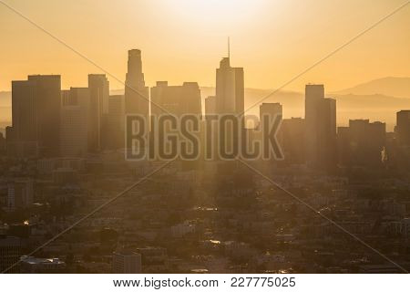 Aerial morning view of rising sun above downtown Los Angeles in Southern California.