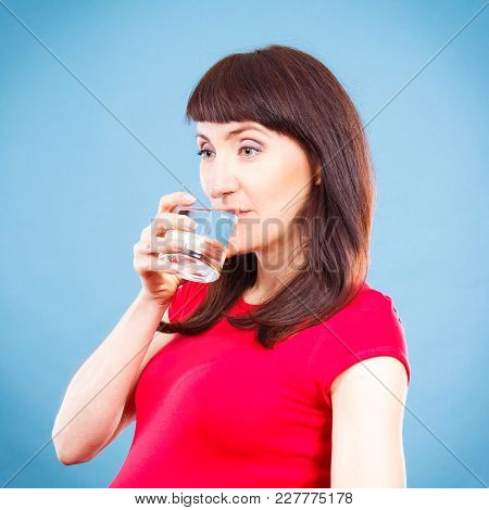 Happy Smiling Woman Drinking Water From Glass, Concept Of Healthy Lifestyle, Nutrition And Hydration