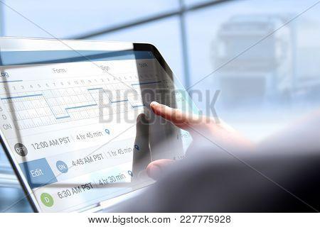 Driver Writing Electronic Log Books Using Laptop