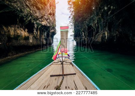 Traveler Concept -  Long Old Wooden Boat Traveling To Hong Islands In Andaman Sea Krabi, South Of Th