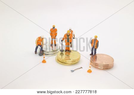 A  Bitcoin With Little Figure On Coins