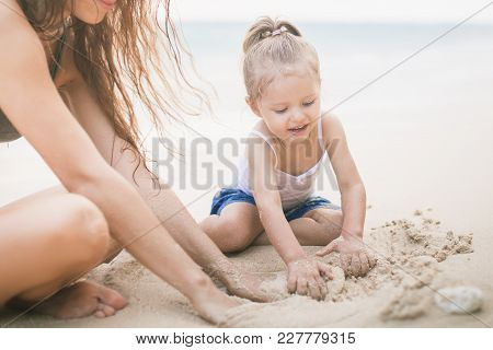 Mom And Happy Baby Playing Near The Beach. Traveling With Your Family, Child. Games With Child Affec