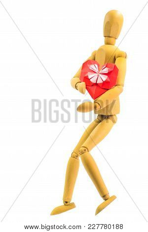 Wooden Puppet Hugging Red Paper Heart Isolated On White Background