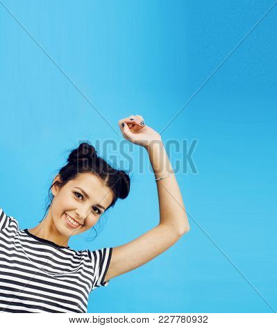 Young Pretty Woman Fooling Around On Blue Background Close Up Smiling Copyspace