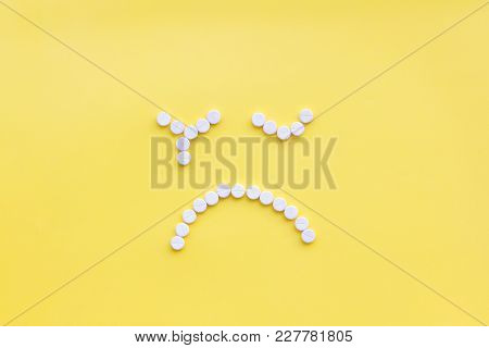 Emotion Management Concept. Overcome Depression. Sad Face Lined With Pills. Yellow Background Top Vi