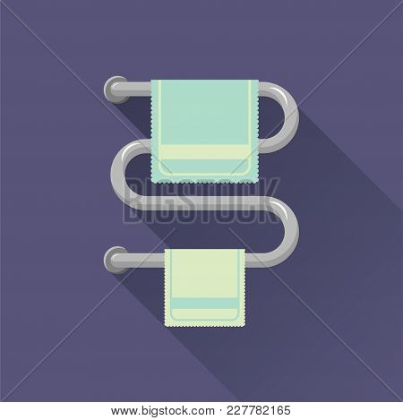 Two Light Green Towels On The Towel Warmer With A Long Shadow