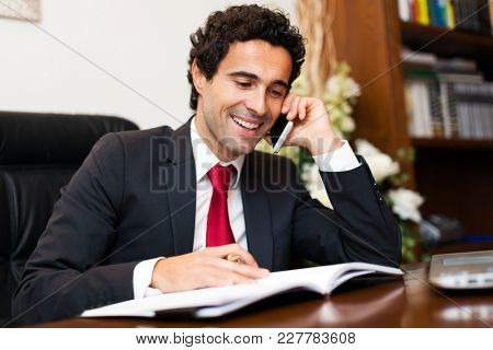 Portrait of a lawyer talking on the phone