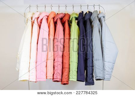 A Collection Of Fashionable Autumn Jackets On Hangers In Shop