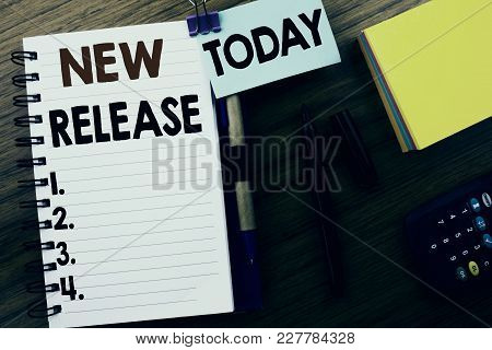 Word, Writing New Release . Business Concept For Technology Software Update Written On Book Note Pap