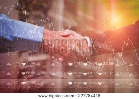 Stocks and shares against handshake of colleagues