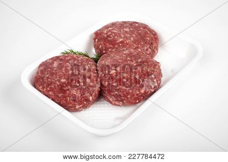 Tray With Raw Beef Burgers Isolated On White Background.