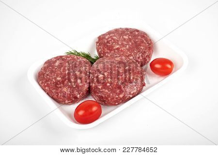 Minced Meat In Plastic Package Isolated On White Background.