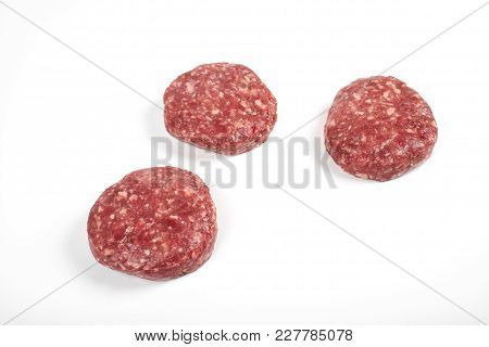 Raw Fresh Large Beef Burger Or Cutlets Isolated On White Background.