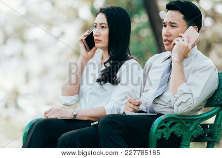 Asian Two Business Men And Woman Work Serious With Smartphone