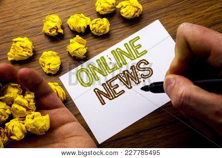 Word, Writing Online News. Concept For Online Newspaper Article Written On Notebook Note Paper On Wo