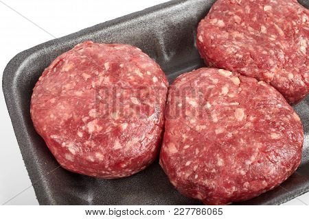 Tray With Raw Beef Burgers Or Minced Meat Isolated On White Background.