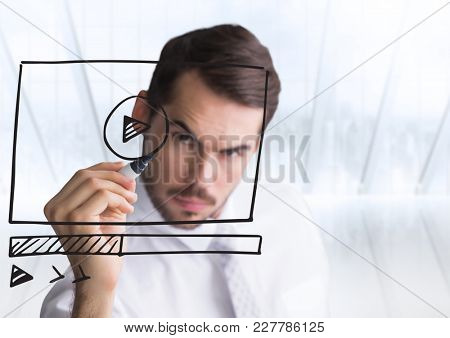 Digital composite of Business man with pen and website mock up against blurry window