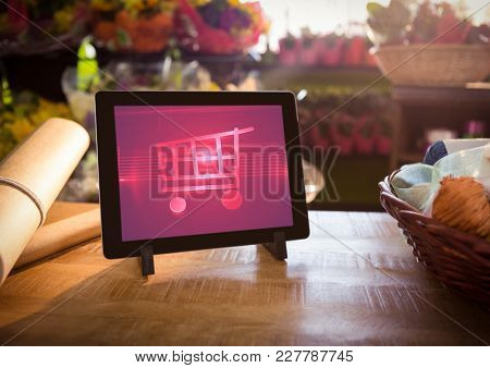 Digital composite of Tablet with Shopping trolley icon in Flower Shop
