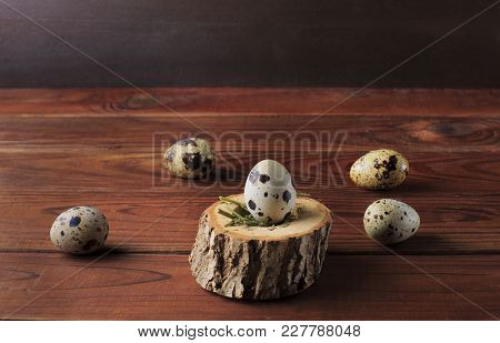 Quail Eggs On The Brown Wooden Table Background. Easter Table. Copy Space.
