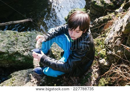 12 Year Old Boy Eating Sandwich Outside In Nature