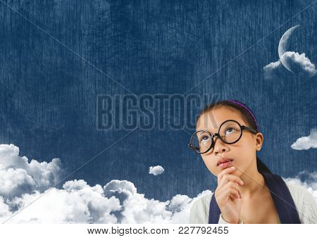 Digital composite of Young Girl looking up at cloudy sky with moon
