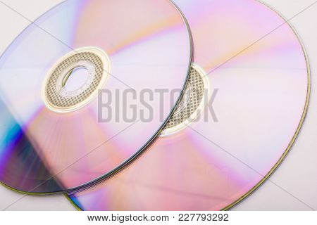 Two Discs Sd, Dvd On White Background Isolate