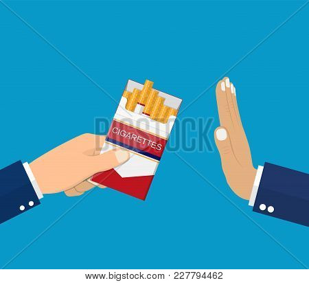 No Smoking. Reject Cigarette Offer. Anti Tobacco Concept. Cigarette Pack In His Hand. Hand Gesture T