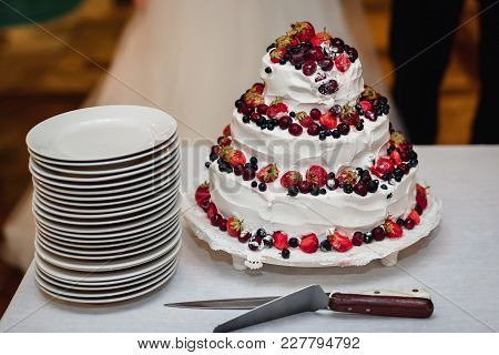 White Cream Wedding Cake With Fresh Sweet Strawberries, Cherries, Blueberries, Black Currants With T