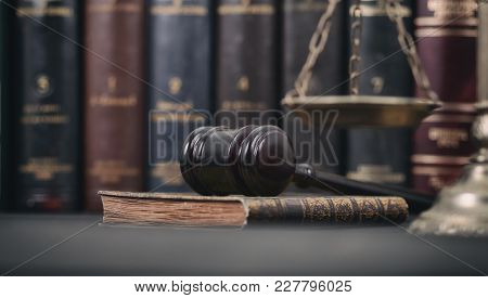 Law And Justice , Legality Concept, Judge Gavel, Law Book And Scales Of Justice On A Black Wooden Ba