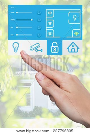 Digital composite of Hand Touching Home automation system App Interface