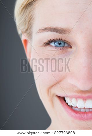 Digital composite of Close up of half woman's face against grey background