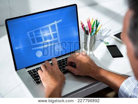 Digital composite of Person using Tablet with Shopping trolley icon