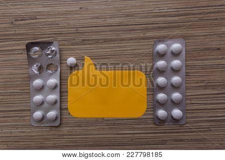 Tablets medicines medicine dose healthy. Tablets in half-empty box. Sticker with label space. poster