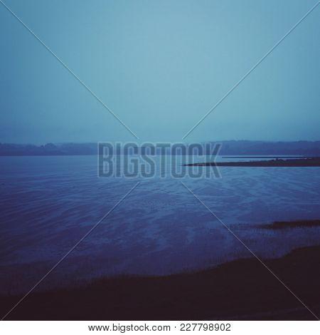 Rainy Summer Night. Russian North. Evening Rain Over Kenozero Lake. Toned Photo. Kenozersky National