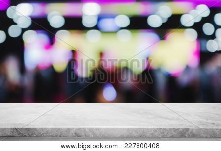 White Marble Stone Table Top And Blurred Bokeh Cafe And Restaurant Background With Vintage Filter -