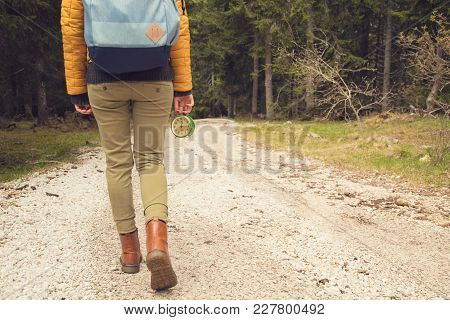 Girl Holding A Vintage Old Clock On A Empty Dirt-road.